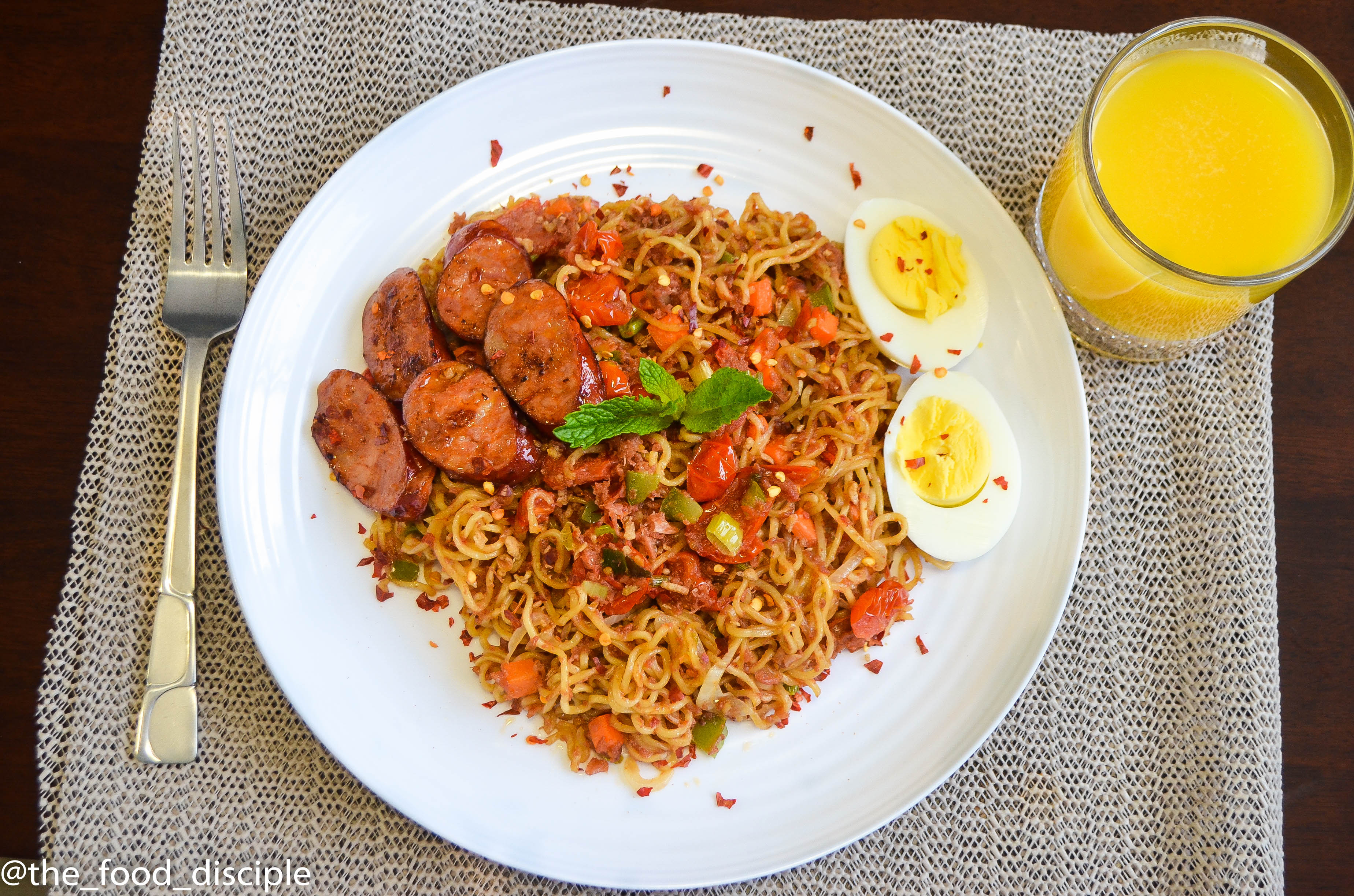 Mi Goreng Noodles served with Pan Seared Linguica and boiled Eggs – The Food Disciple