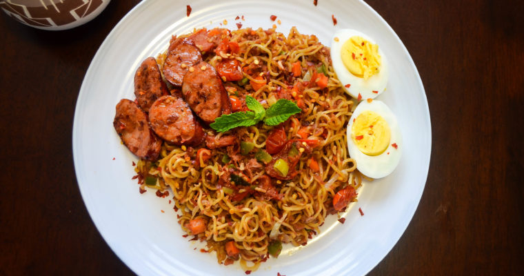Mi Goreng Noodles served with Pan Seared Linguica and boiled Eggs