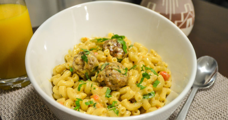 Sausage Balls served on Creamy Macaroni