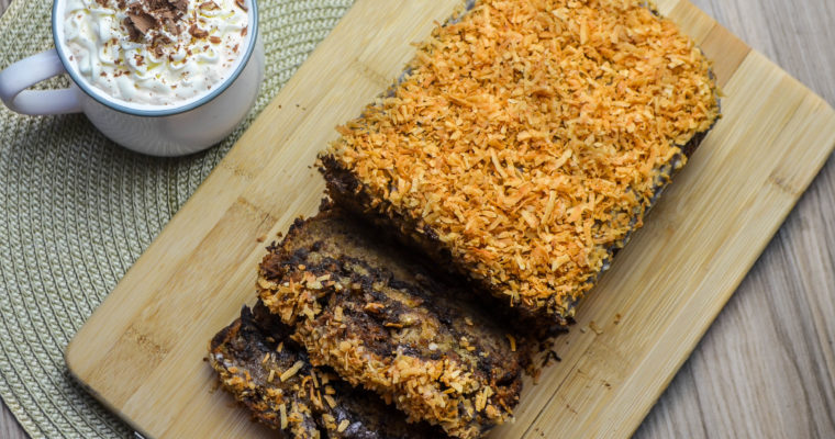 Extra Moist Chocolate Banana Bread topped with Coconut glaze & Toasted Shredded Coconut