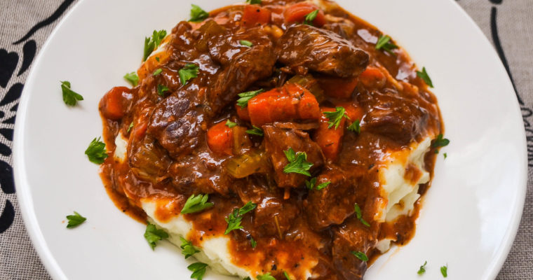 Slow Cooker Beef Stew served on Mashed Potatoes
